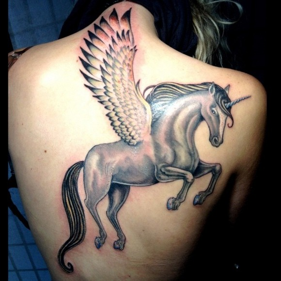 Large Unicorn Tattoo With The Wings On The Back