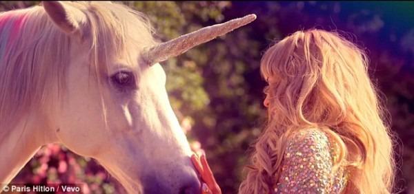 Paris Hilton Pets A Unicorn In A Rainbow