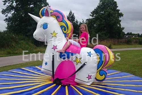 Unicorn Party Fun With Our Inflatable Unicorn Ride Hire