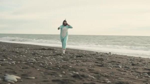 Crazy Woman Is Wearing Kigurumi Costume Of The Unicorn Is Running