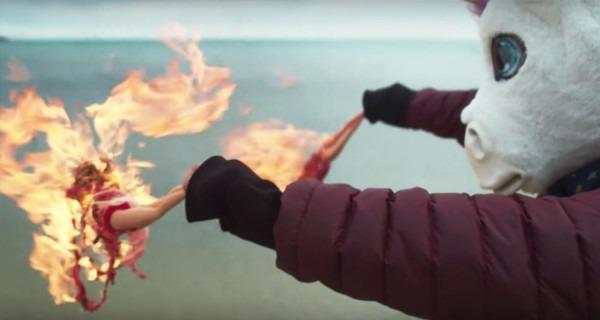 Watch Mark Waldoch Don A Unicorn Head, Burn Barbie Dolls In Video