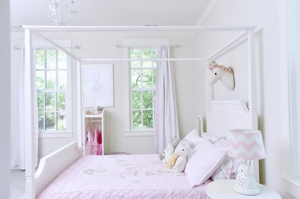 Felt Unicorn Head Over White Canopy Bed