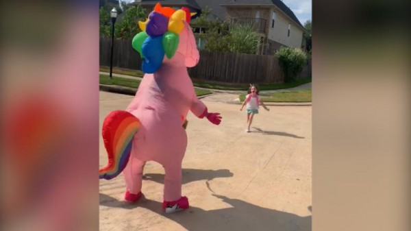 Mom Of The Year Dressed Up As A Massive Pink Unicorn To Surprise
