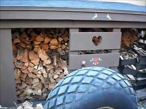 Splitting Firewood Using The Unicorn Log Splitter On The Massey